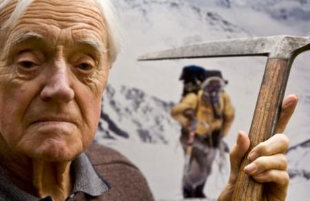 Alfred Gregory holds the ice ax he used on the 1953 Everest acsent. Photo The Age by Joseph Feil.