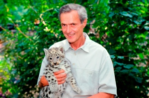 George Schaller with snow leopard cub. Photo by WCS.