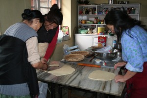 Doma (r) making Tibetan Khapsey. Photo by Sibylle.